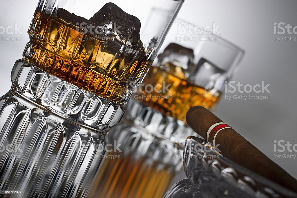 Glass of whiskey with a cigar royalty-free stock photo