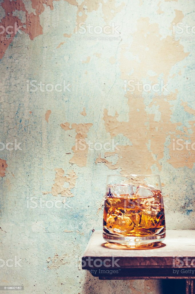 Glass of whisky in bothy stock photo