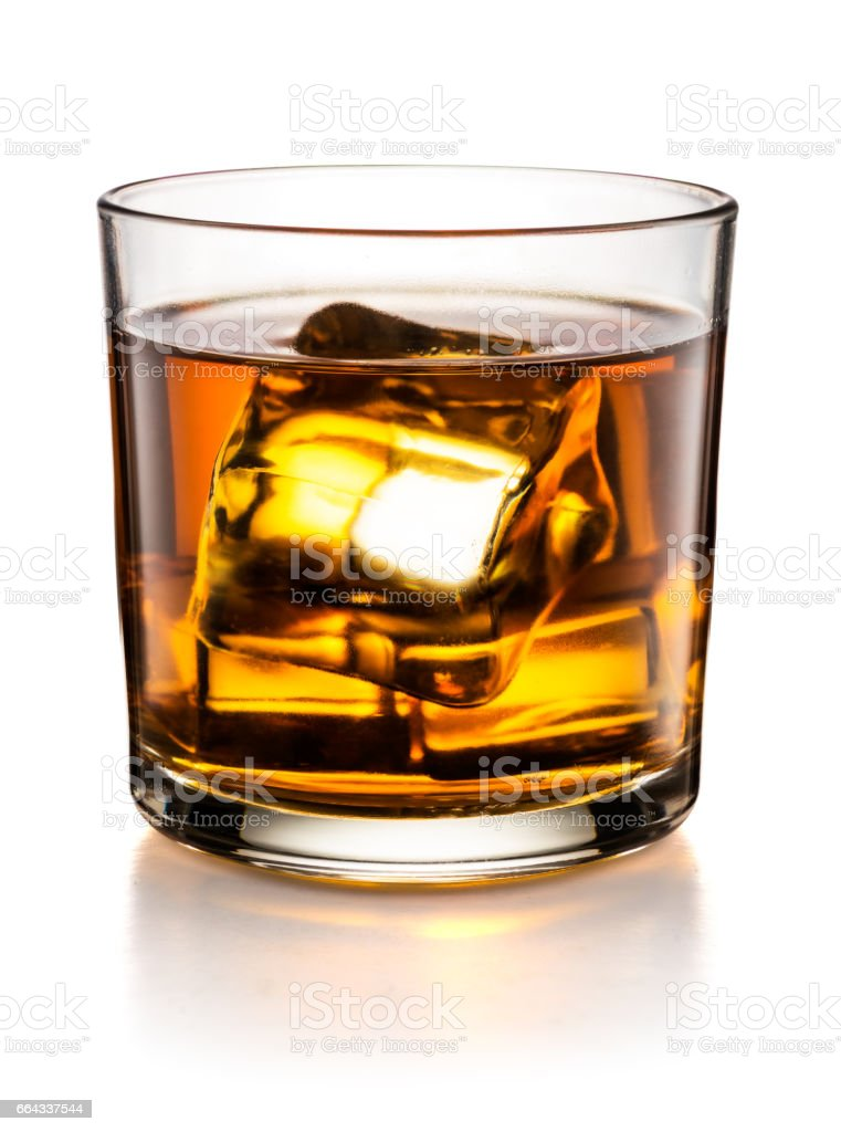 Glass of whisky isolated on white background stock photo