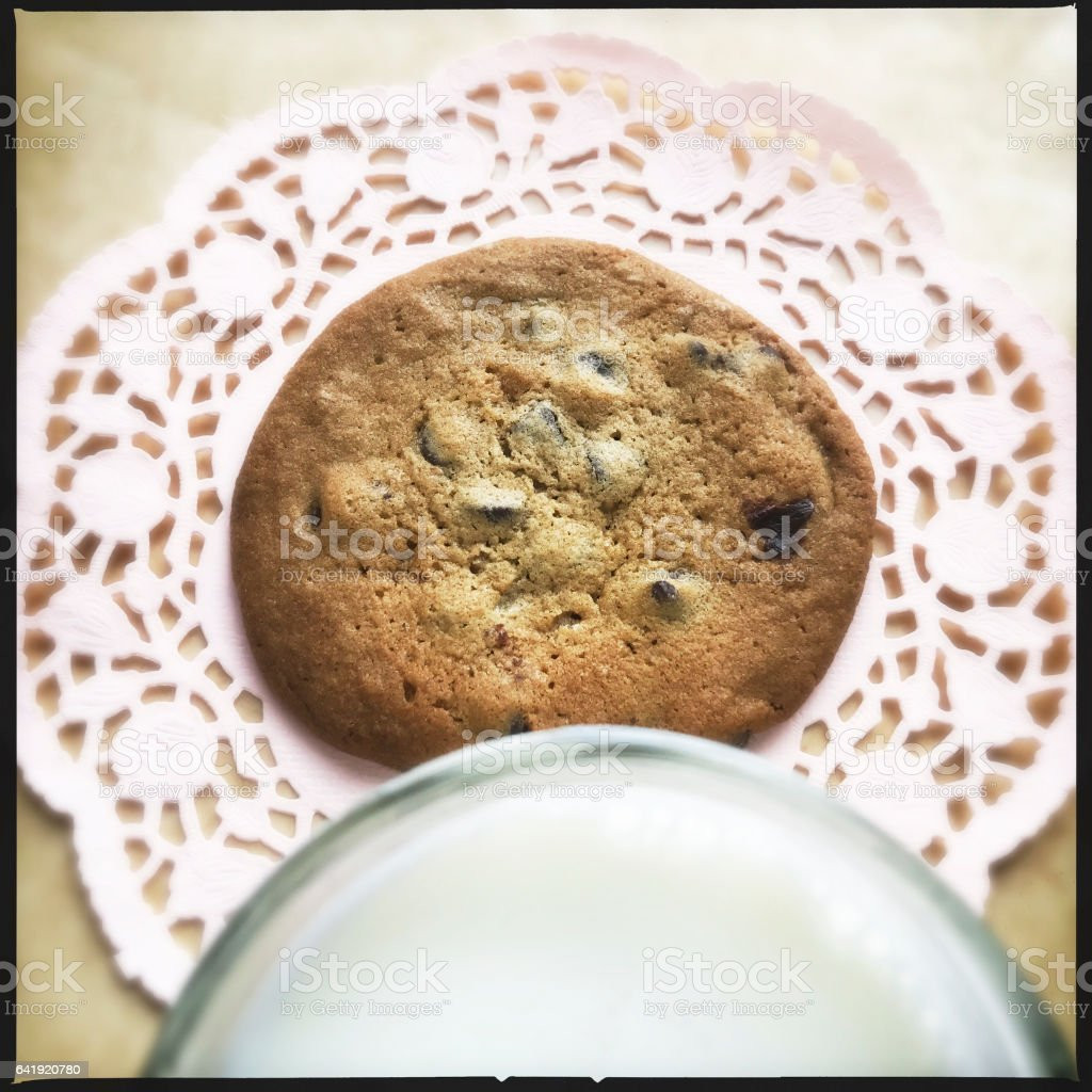 Glass of White Milk and Chocolate Chip Cookie stock photo