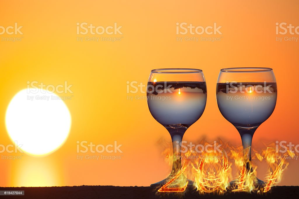 Glass of white vine with reflections of houses stock photo