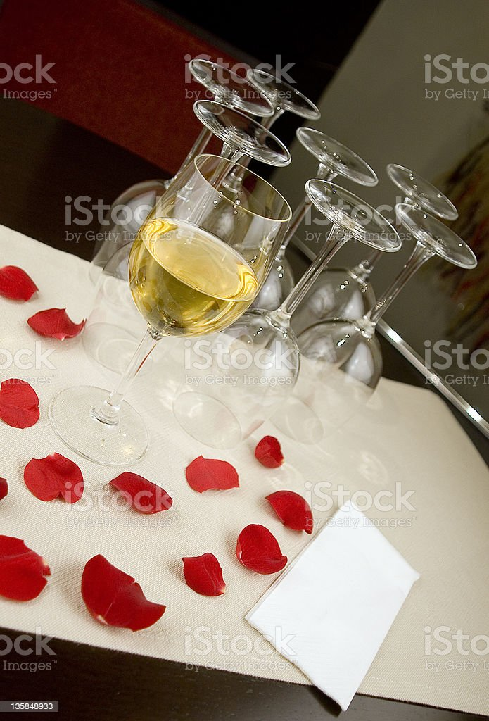 Glass of white wine and red rose petals, Istanbul, Turkey royalty-free stock photo