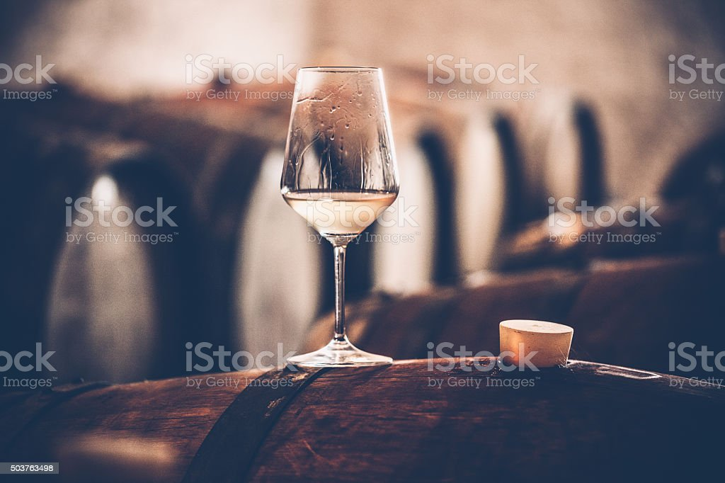 Glass of Wine on a Barrel stock photo