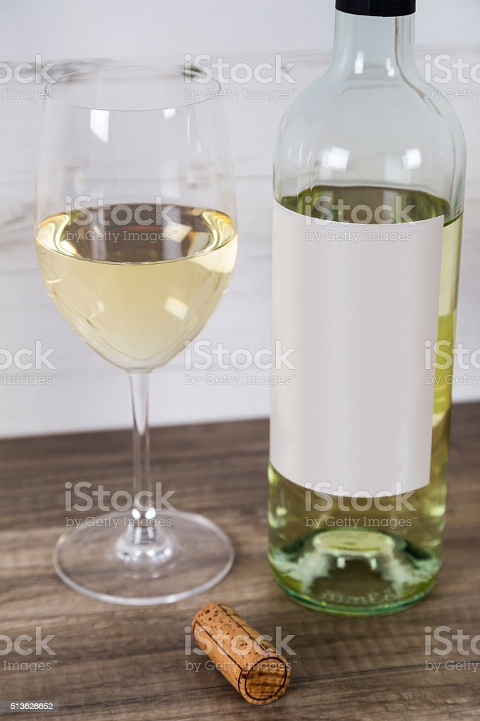 Glass of White Wine with Bottle stock photo