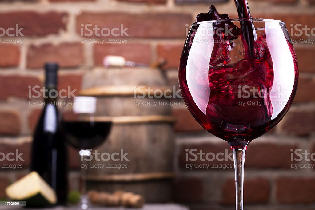 Glass of wine against a brick wall royalty-free stock photo