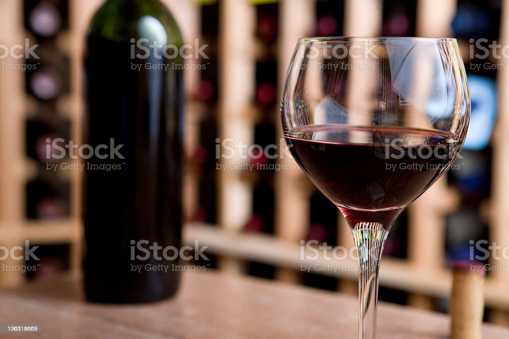 Glass Of Wine and Bottle In Cellar royalty-free stock photo