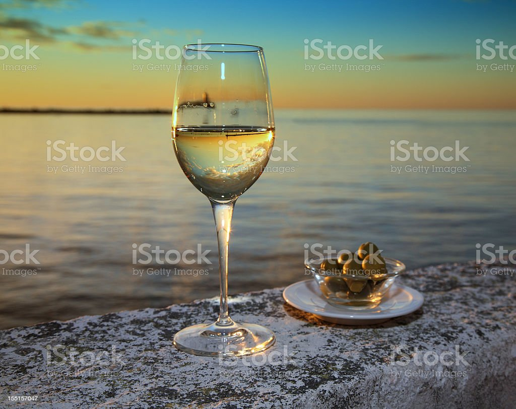 Glass of Wine and Olives by the Sea royalty-free stock photo