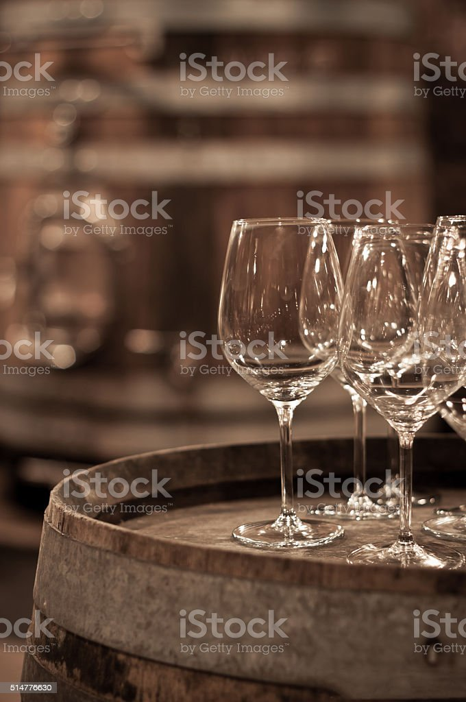 Glass of wine in the wine cellar stock photo