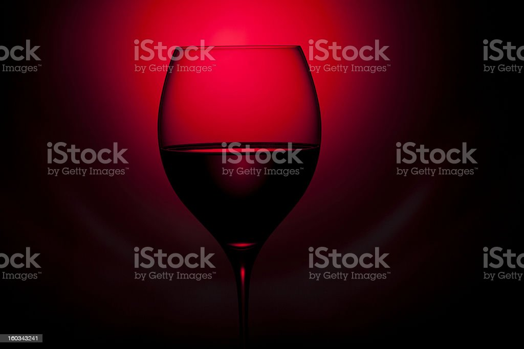 glass of wine is on the red and black background royalty-free stock photo