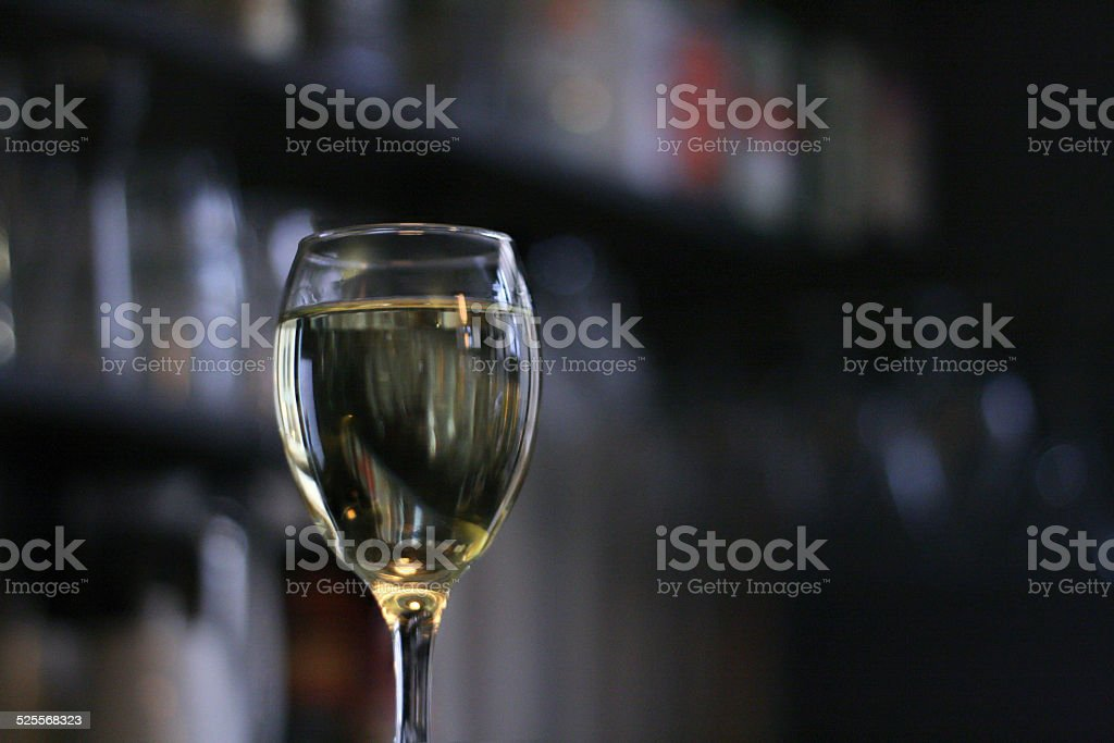 Glass of wine on bar stock photo