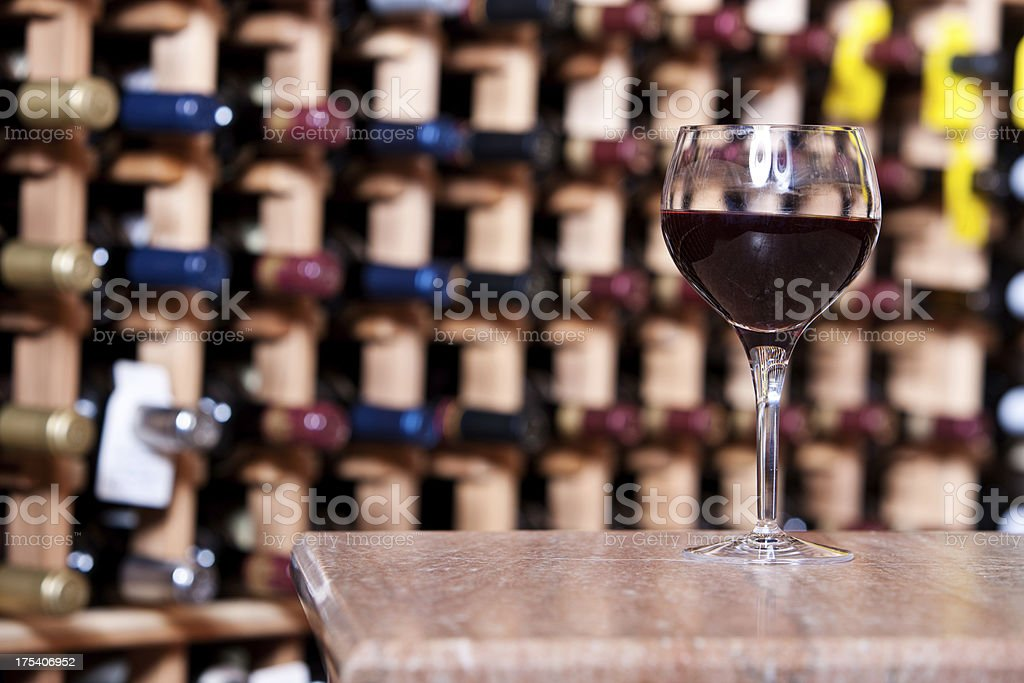 Glass of Wine on Table in Cellar royalty-free stock photo