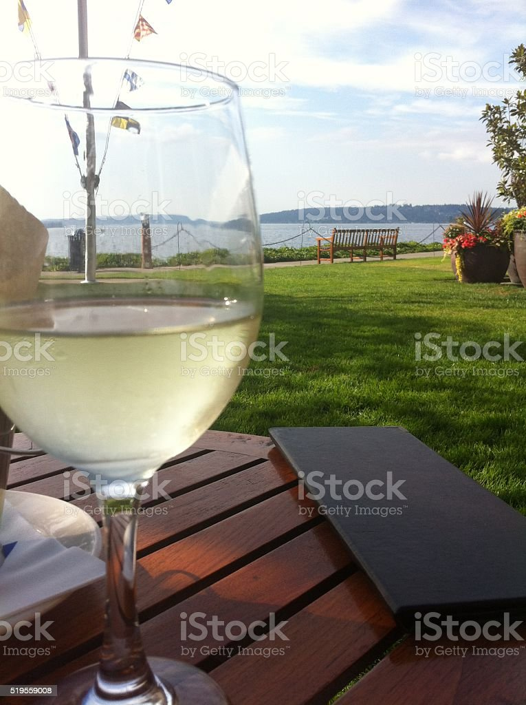 Glass of wine on the lake stock photo