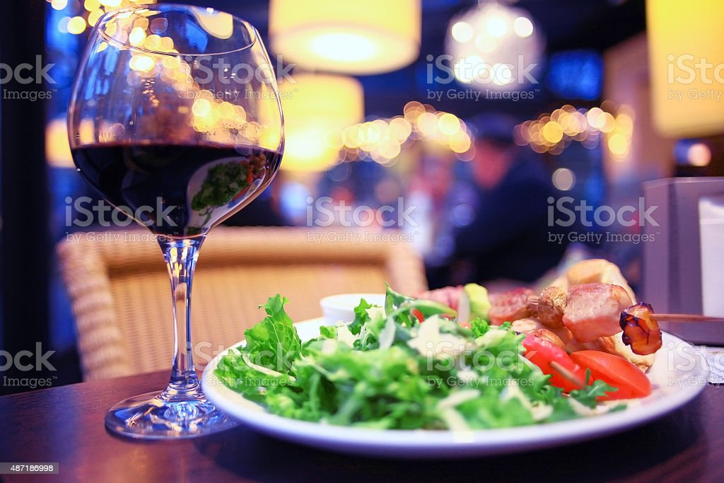 glass of wine restaurant interior serving dinner stock photo