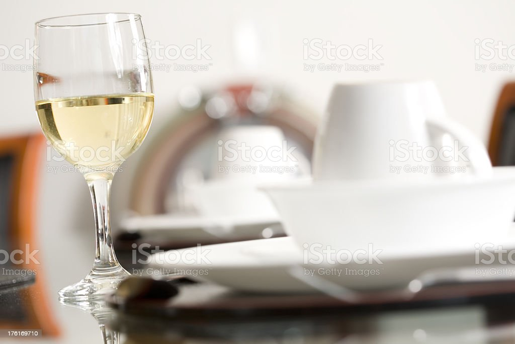 Glass of wine with a nice dinner place setting royalty-free stock photo