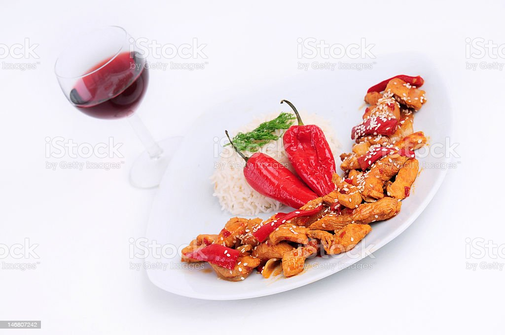 Glass of wine with a plate rice and  special chicken royalty-free stock photo