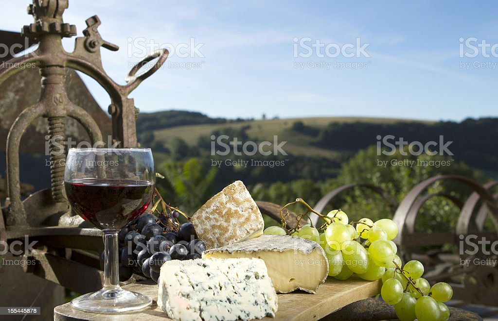 Glass of wine with a selection of cheese stock photo