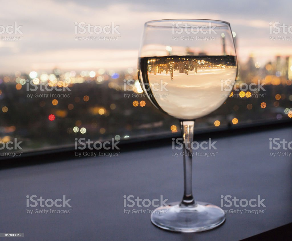 Glass of wine with city view stock photo