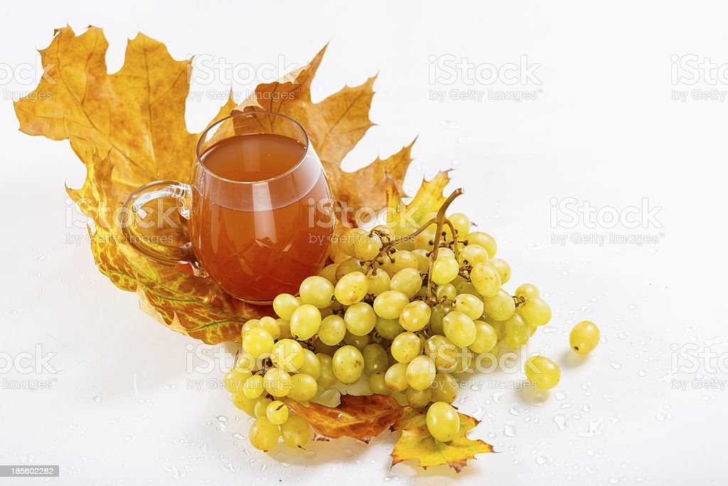 Glass of wine with grapes and leaves royalty-free stock photo