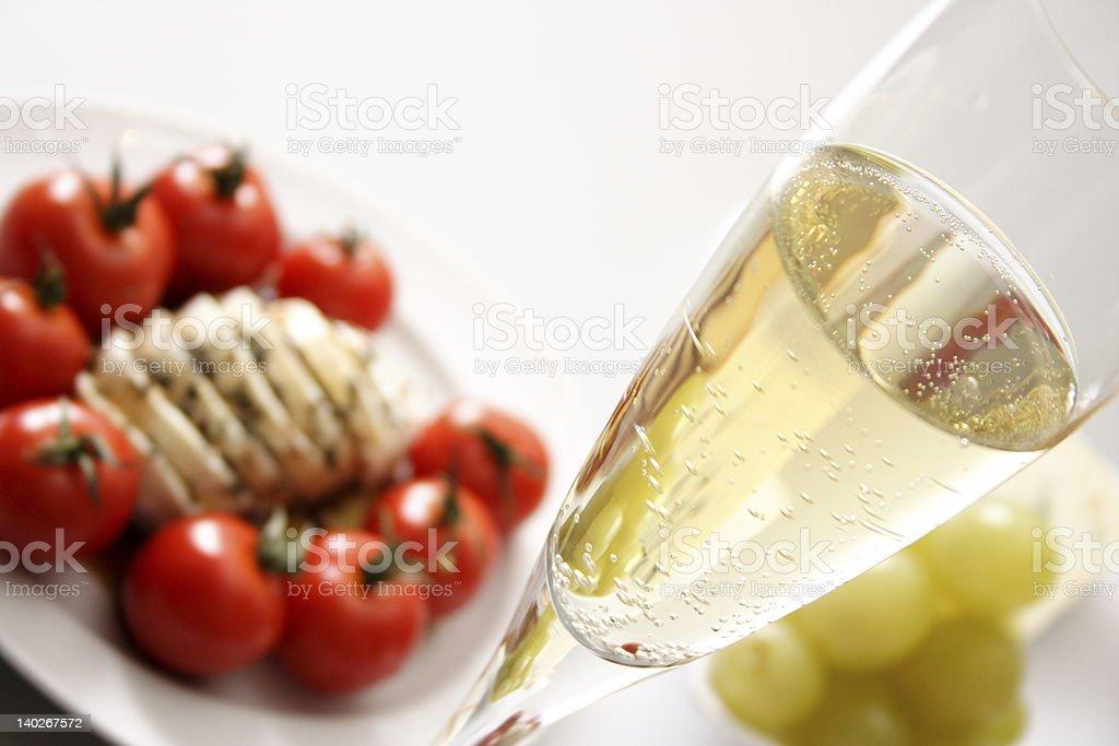 Glass of wine with Mozzarella and tomato stock photo