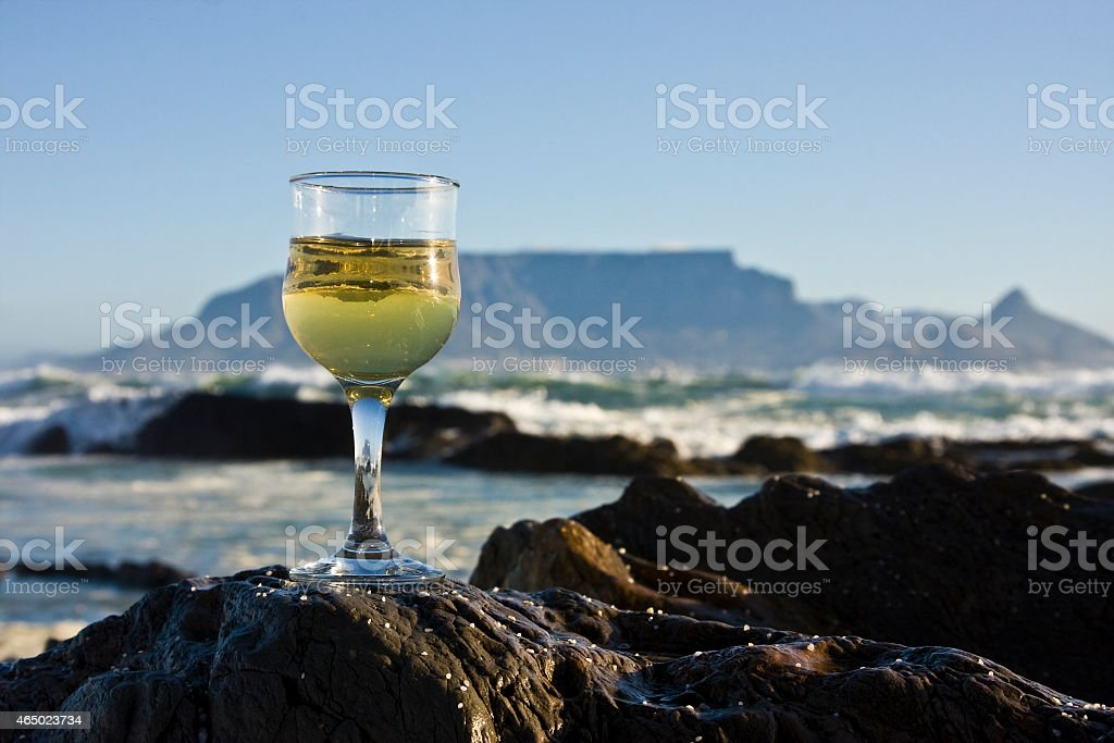 Glass of wine with Table Mountain in the background stock photo