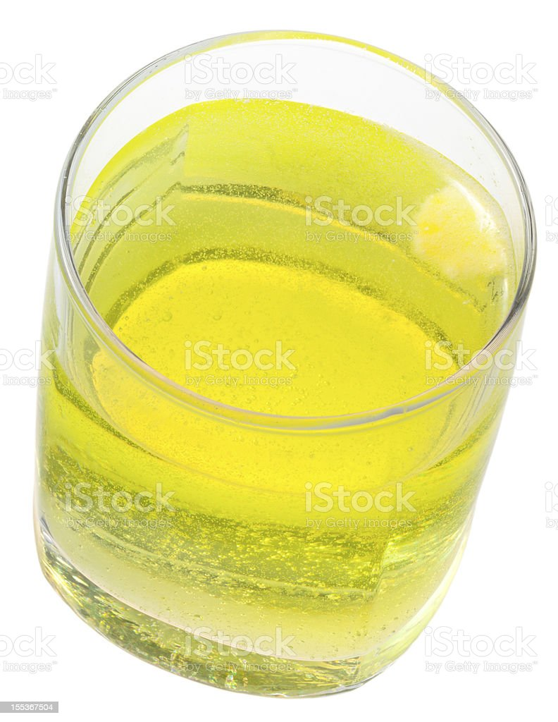glass of yellow carbonated water with vitamin C royalty-free stock photo