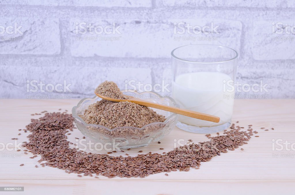Glass of yogurt and flax seeds, whole and grounded royalty-free stock photo