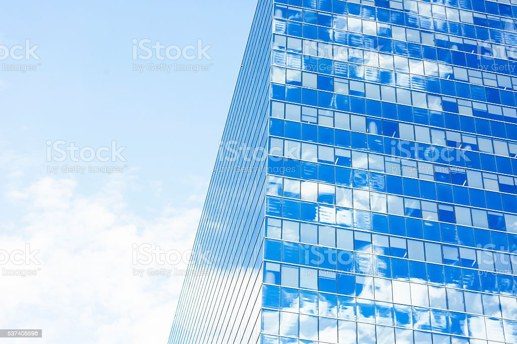 Glass office building with reflection of sky, background, copy space stock photo