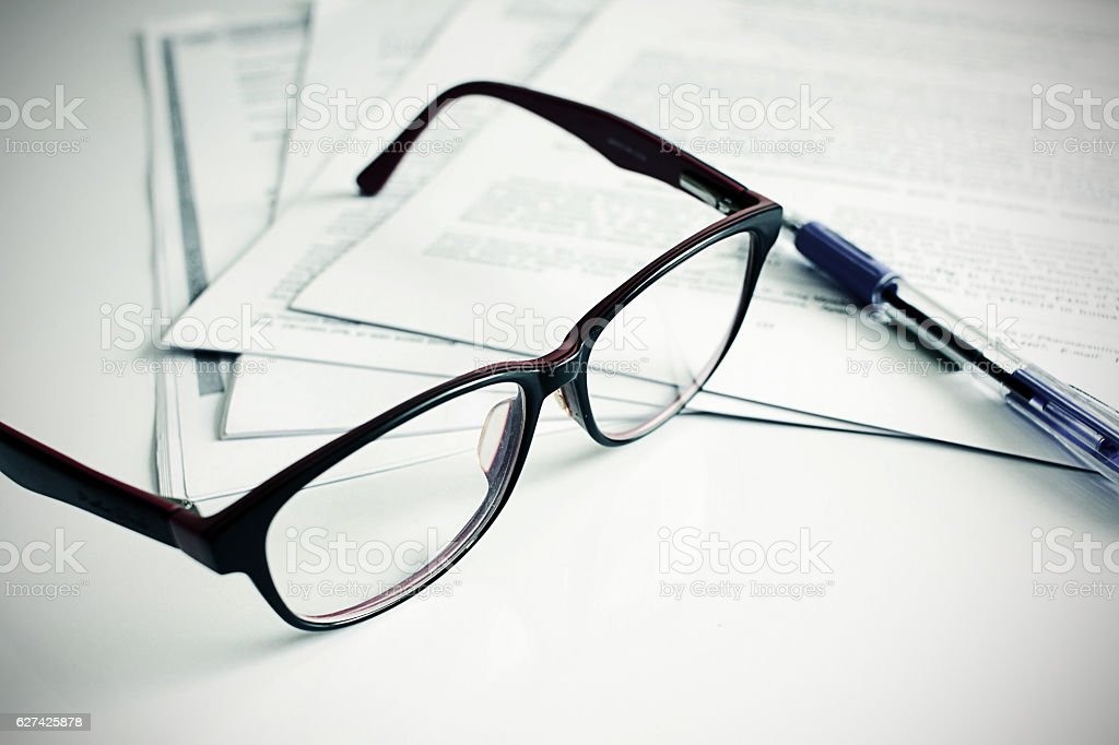Glass, pen and paper sheet stock photo