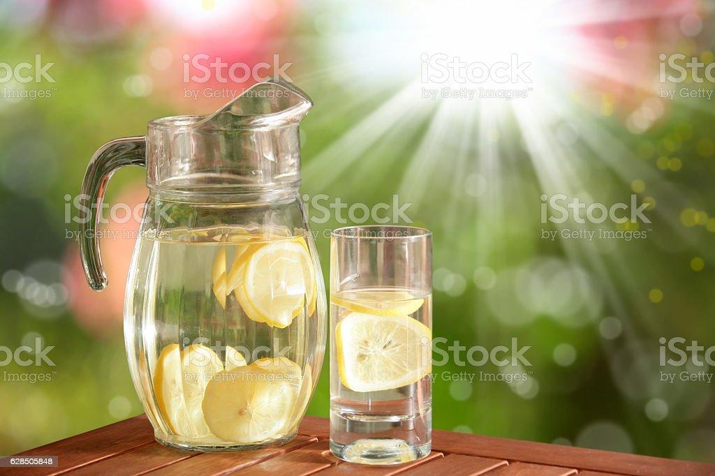 glass pitcher of fresh lemonade stock photo
