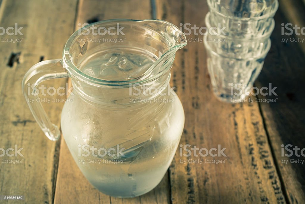 Glass pitcher of water and glass. stock photo