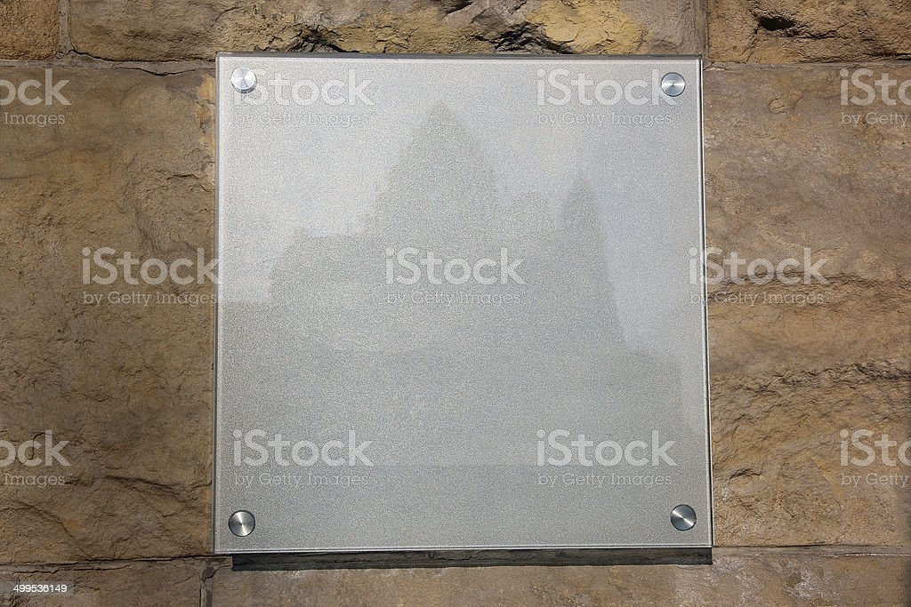 glass plate with a castle image on a stone background stock photo