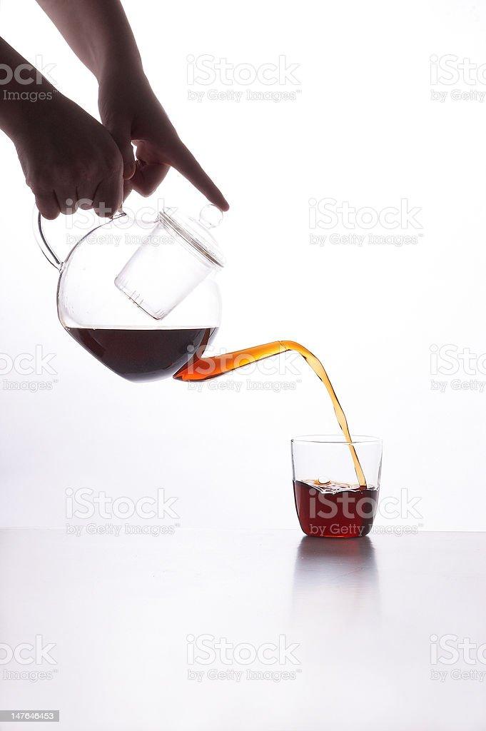 Glass pot pouring tea royalty-free stock photo