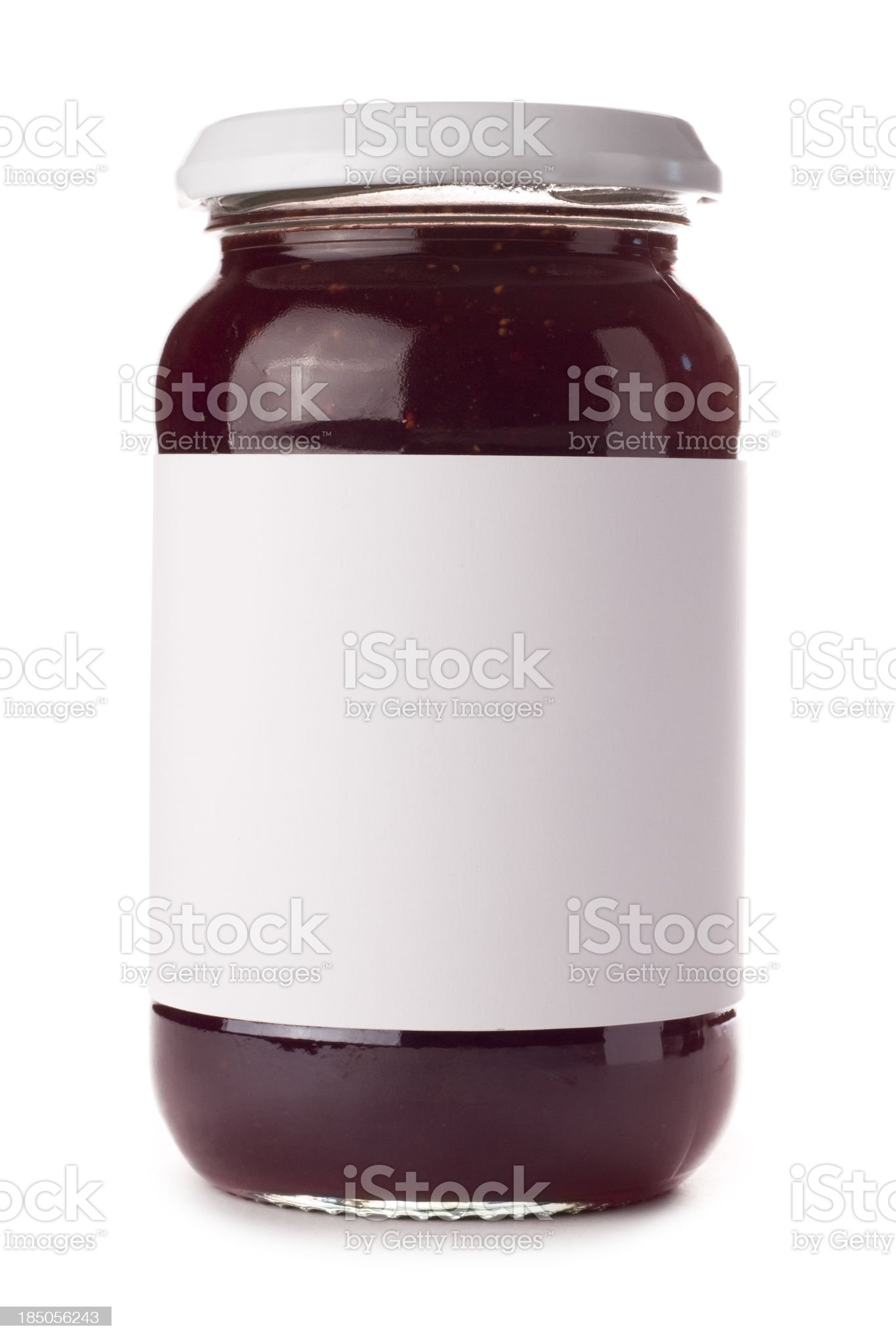 Glass preserve jar with blank label on a white background royalty-free stock photo
