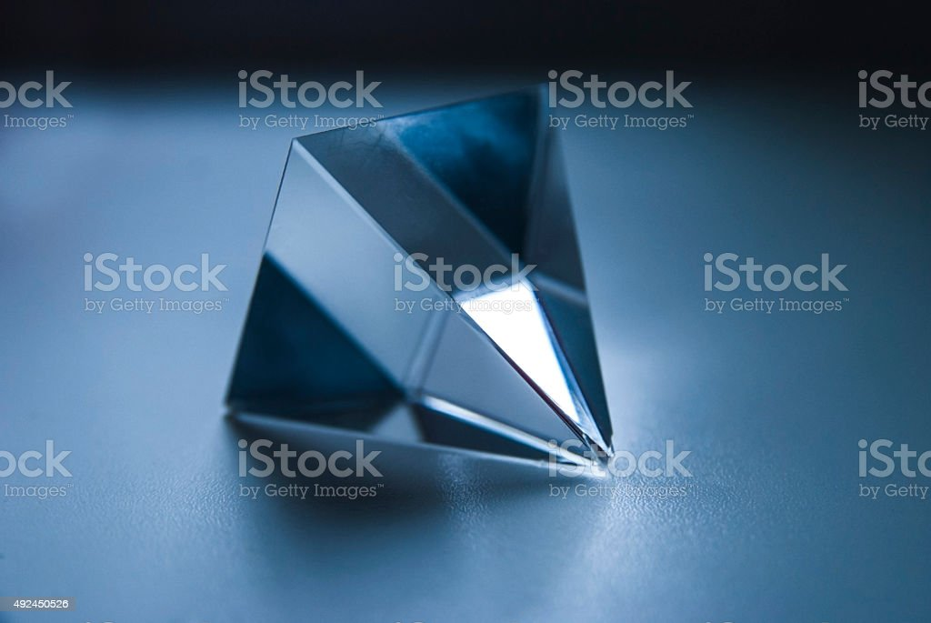 Glass Prism. The Pyramid. Geometric Forms. Science. stock photo