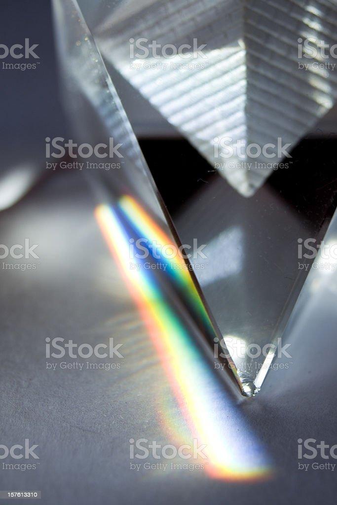 Glass pyramid emiting natural colors. stock photo