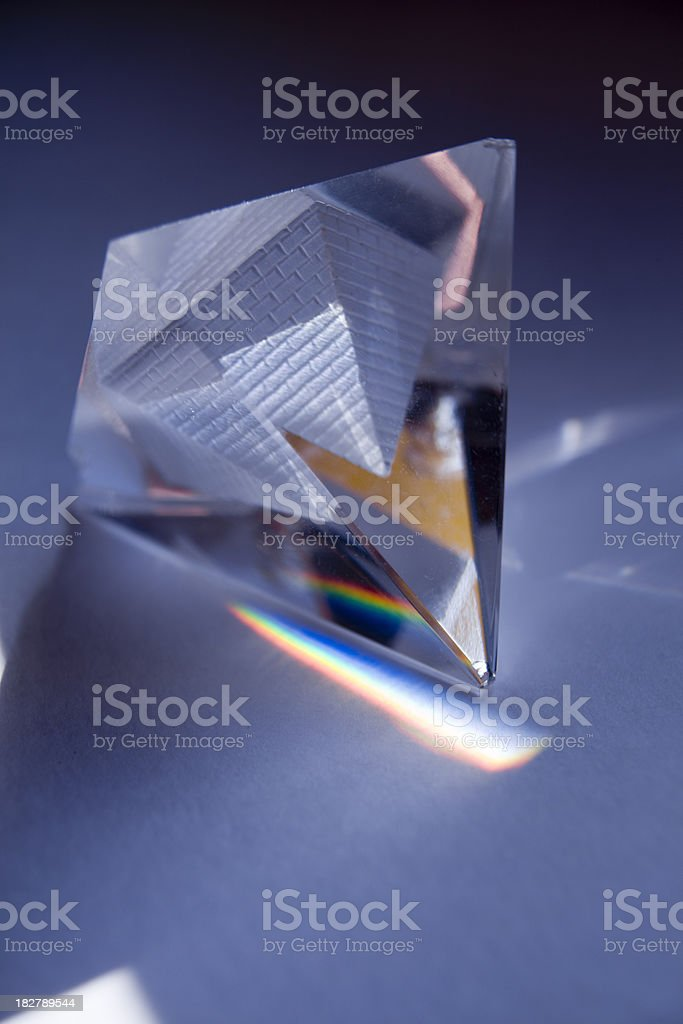 Glass pyramid emiting primary colors. stock photo