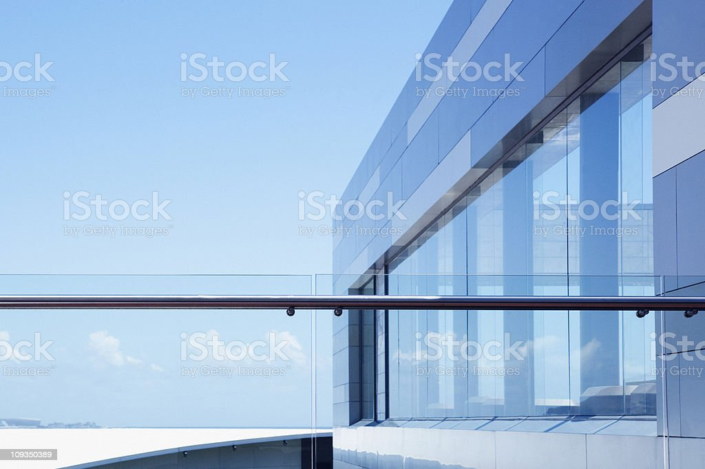 Glass railing on modern building balcony stock photo