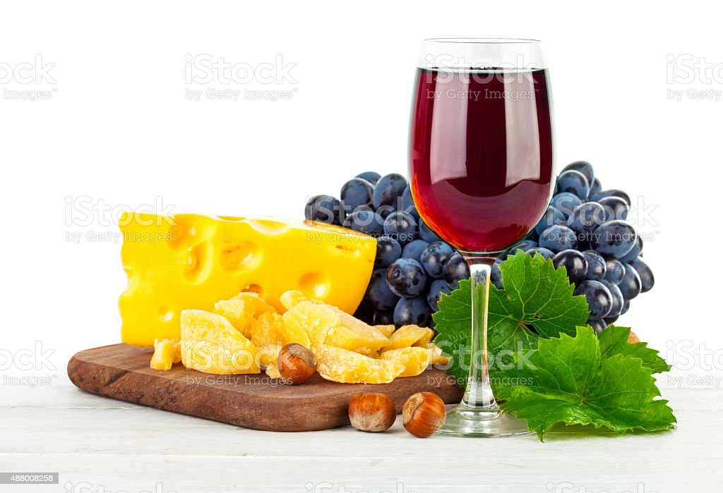 Glass red wine with grapes and cheese stock photo