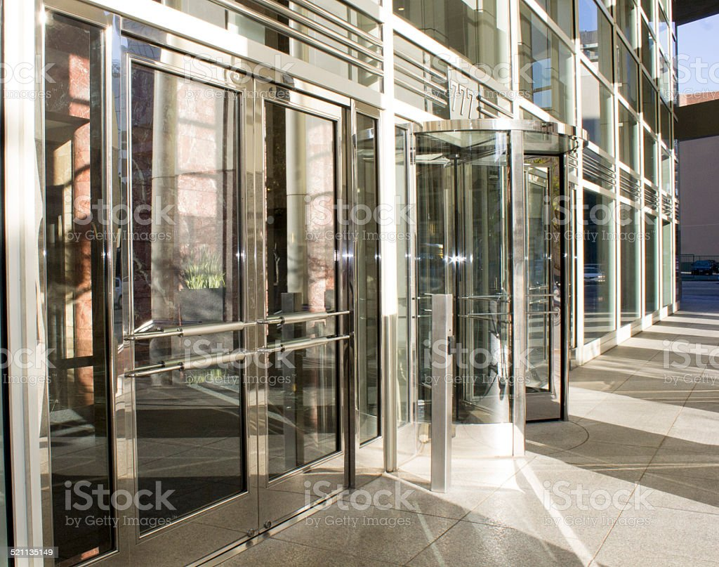 Glass Revolving Doors with Lens Flare stock photo