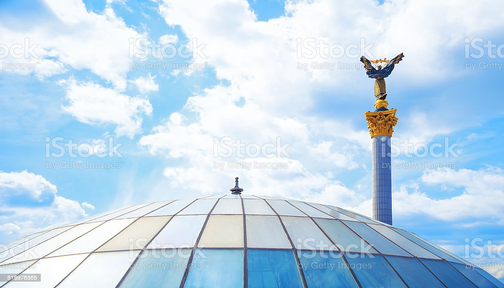 Glass roof and a statue of independence maidan in Kiev stock photo