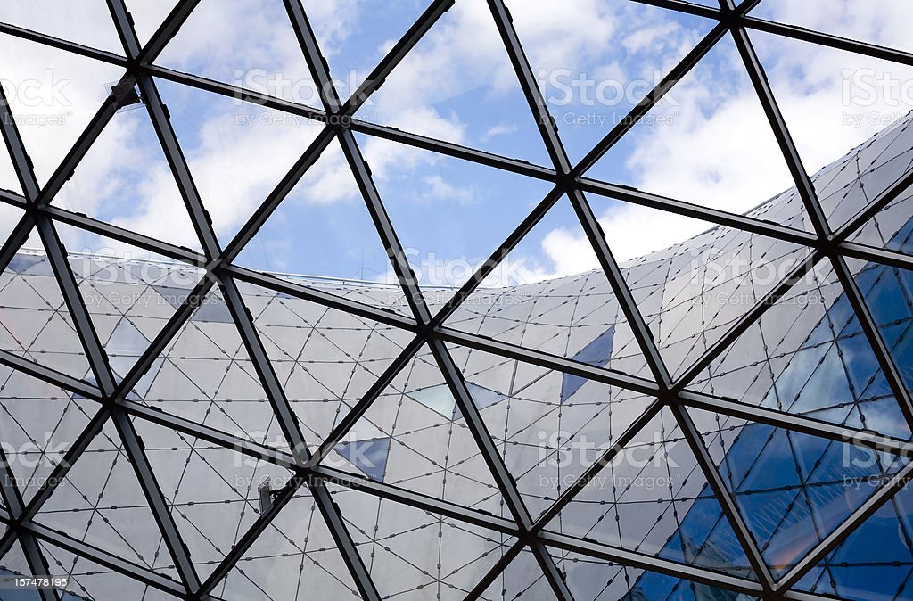 Glass roof construction, cloudy sky royalty-free stock photo