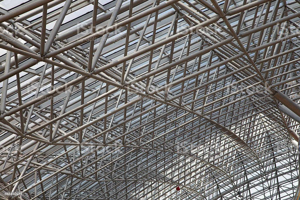 Glass roof with metal structure in perspective royalty-free stock photo