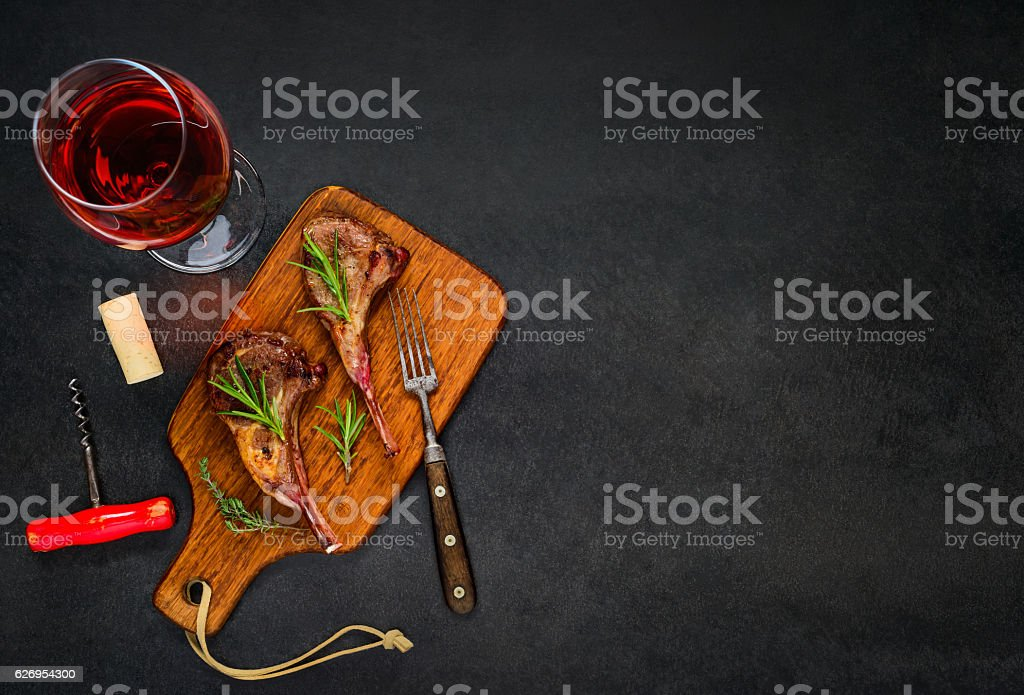 Glass Rose Wine with Lamb Steak on Copy Space stock photo