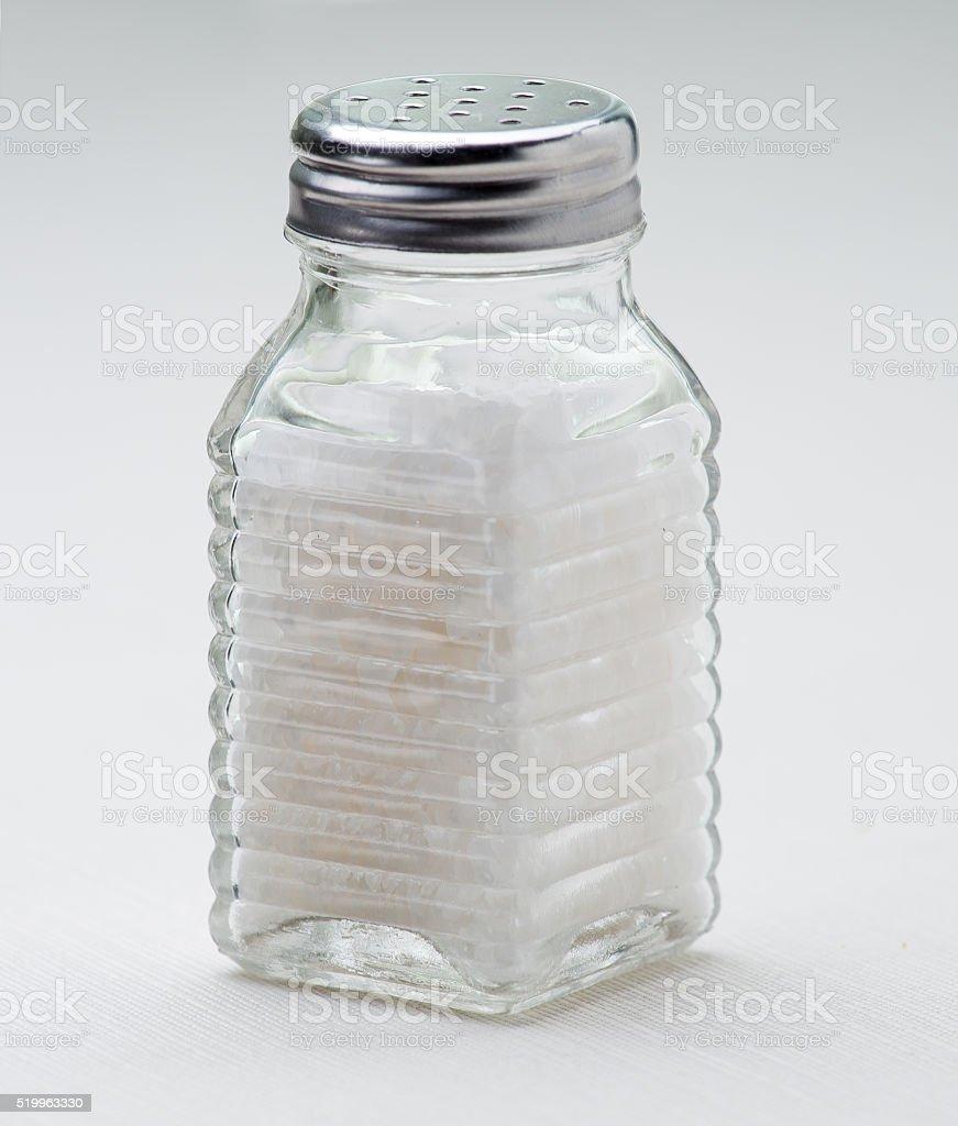 Glass salt shaker. stock photo