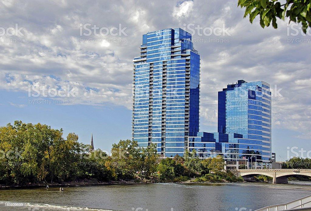 glass skyscraper on a river stock photo