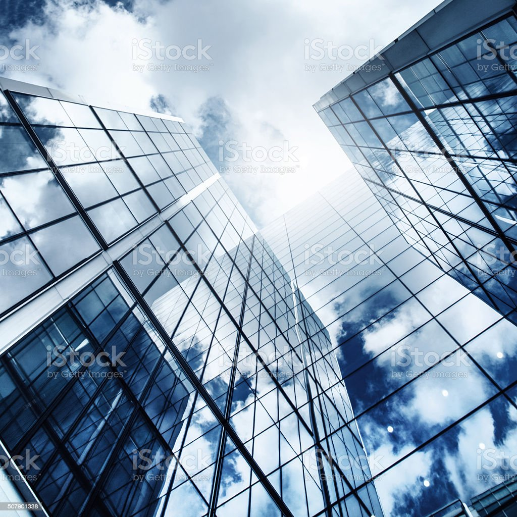 glass skyscraper reflecting the blue sky stock photo