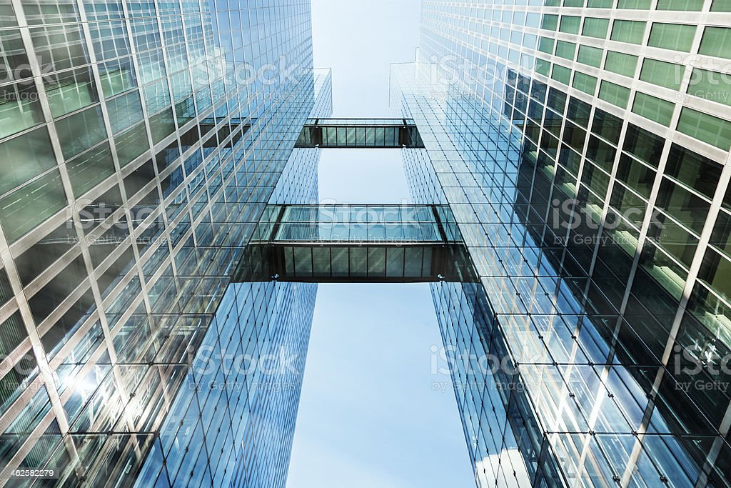 Glass Skyscraper With Two Elevated Walkways Against Blue Sky royalty-free stock photo