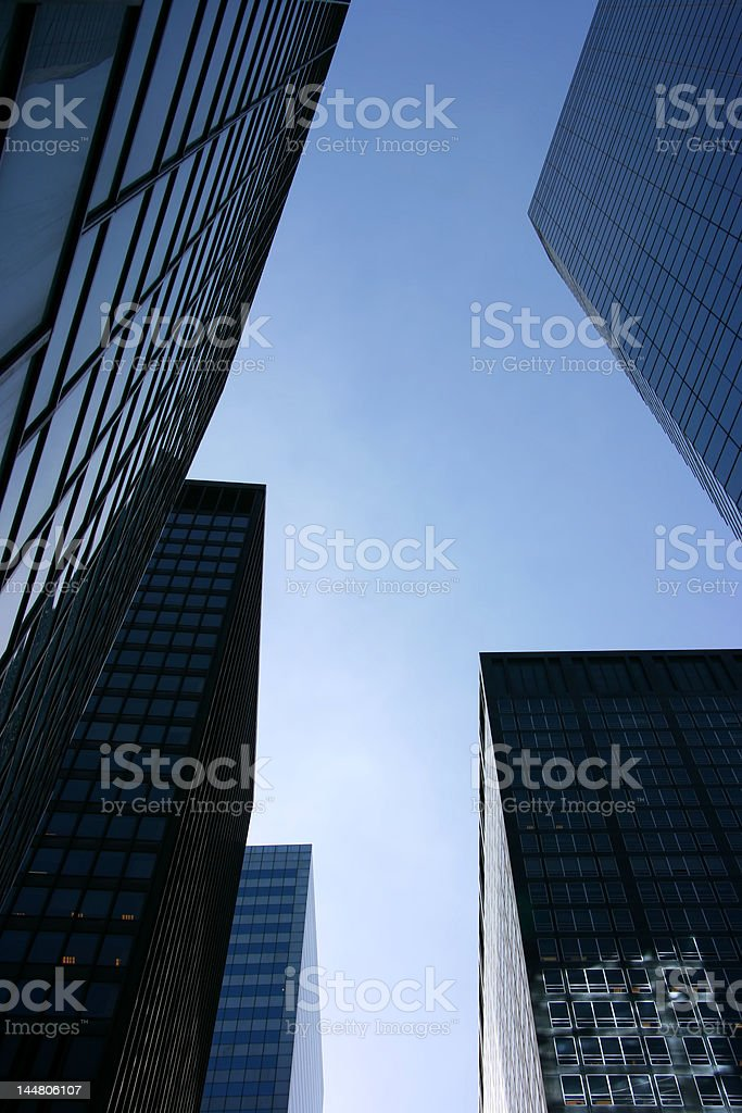 Glass skyscrapers in the financial district, New York, vertical royalty-free stock photo