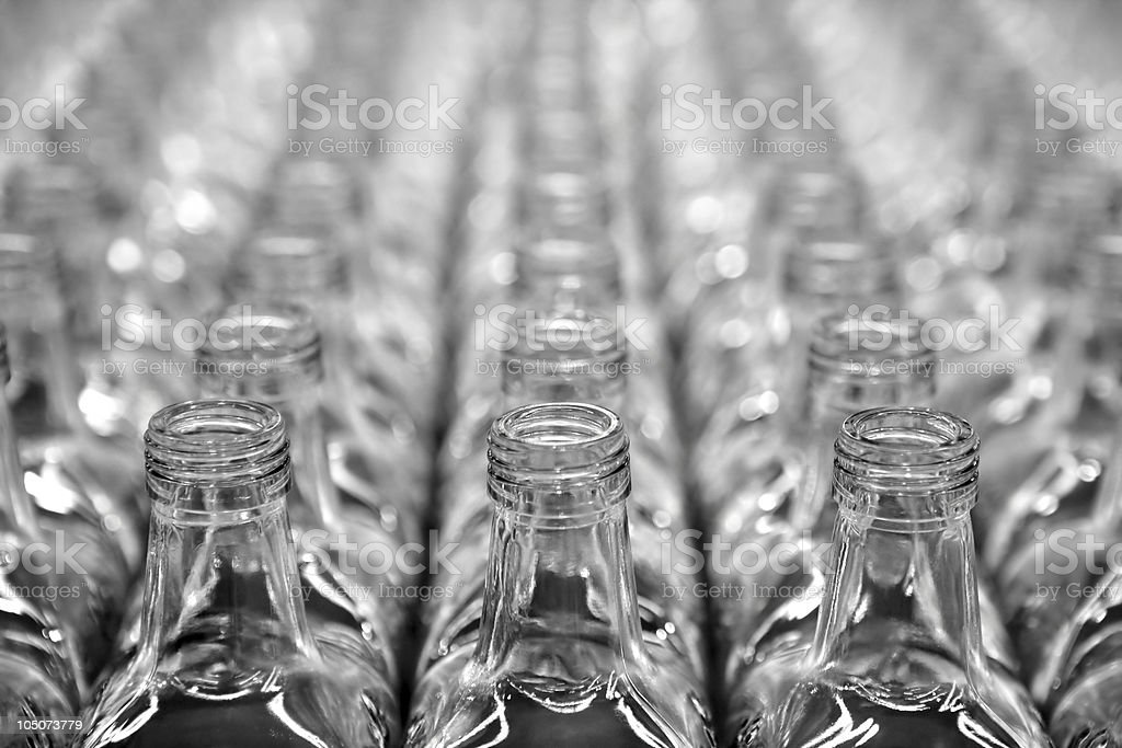 Glass square transparent bottle rows stock photo