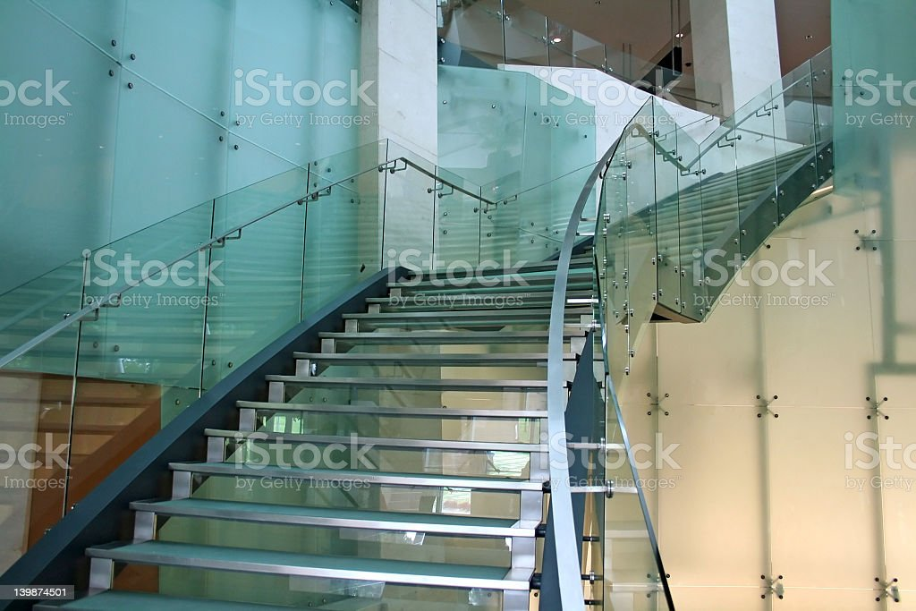 Glass stairs with metal handrails seen from below stock photo